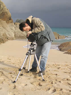 Ian Flory desparately rescuing his film from the Atlantic Ocean.
